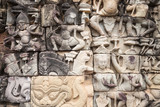 Ancient ruins and bas relief in Siem Reap Park, Cambodia