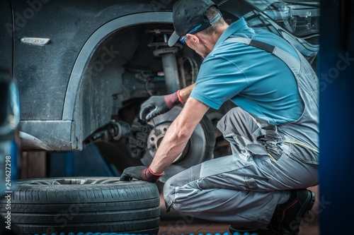 Car Mechanic at Work - 241627298