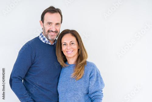Leinwanddruck Bild Beautiful middle age couple in love over isolated background with a happy and cool smile on face. Lucky person.
