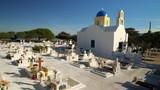 Classic greek orthodox blue domed church and cemetery on the mediterranean island of Santorini, Greece - 241647859