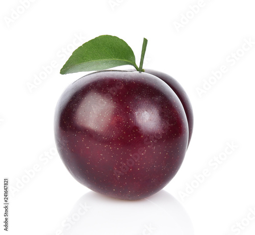 red cherry plum with green leaves isolated on white background