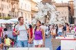 Europe travel tourists couple walking in Rome, Italy, on Piazza Navona, famous tourism attraction. Street city lifestyle, summer holidays. People relaxing enjoying life.