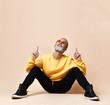 Leinwandbild Motiv Portrait of gray hair senior millionaire man in yellow sunglasses pointing fingers up
