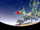 Satellite view of Ireland from space at night. Beautifully detailed plastic planet surface with visible city lights.