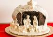 chocolate nativity scene. Traditional panettone with the white chocolate nativity scene
