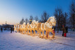 """New year's installation in the Museum-reserve """"Tsaritsyno"""". Fabulous glowing coach, drawn by six horses glowing. Moscow, Russia"""