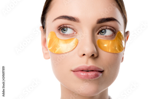 Leinwanddruck Bild close up of beautiful woman with golden eye patches isolated on white