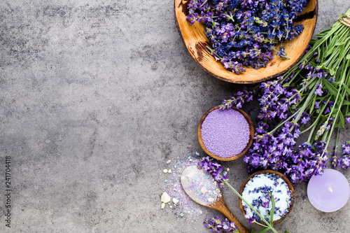 Essential lavender salt with flowers top view.