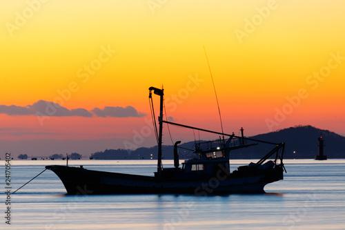 obraz lub plakat Anchored sea fishing boat. sunset and fishing boat. korea west sea. Ganghwa-gun, Incheon, Republic of Korea.
