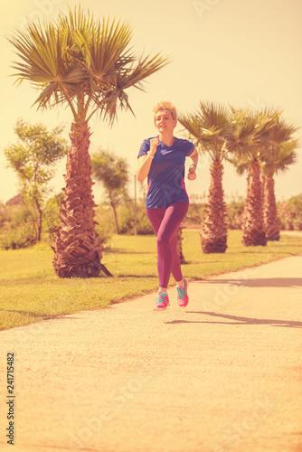 Leinwanddruck Bild young female runner training for marathon