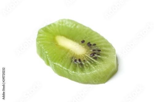 closeup of Kiwi slice on white background