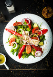 Delicious Greek salad of fresh vegetables on a plate - 241722213