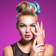 Beautiful woman with fashion hairstyle and pink nails.