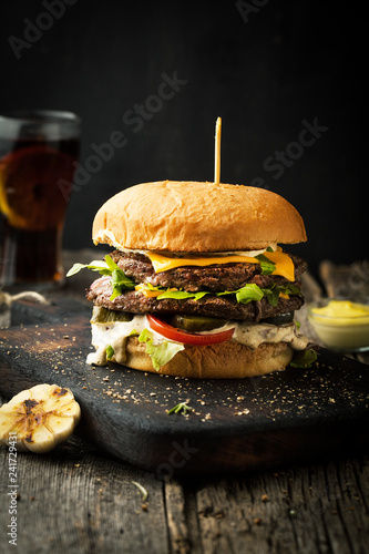 Delicious double cheeseburger with arugula and sauce