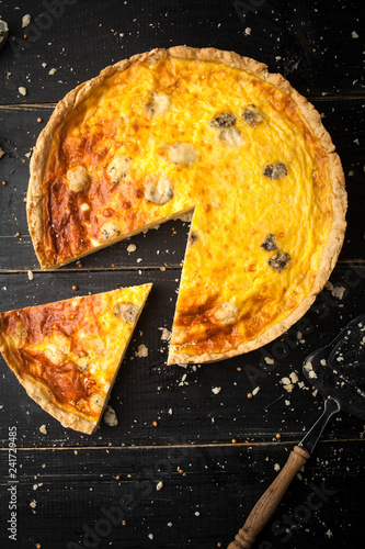 Delicious quiche with cheese and mushrooms