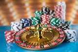 Poker Chips, Roulette wheel in motion, casino background - 241732235