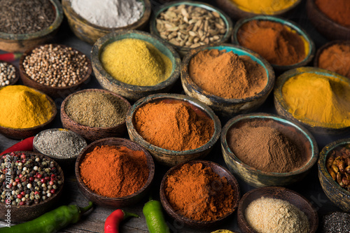 Hot spices in wooden bowls