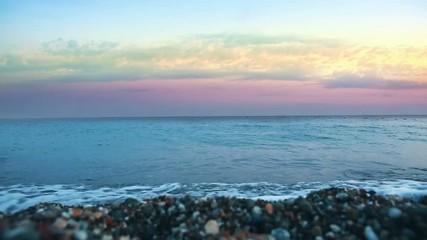 Sunset on greek pebble beach. Sea background. © Swetlana Wall