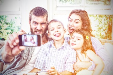 Happy family taking a selfie © vectorfusionart