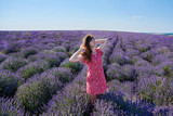 Young brunette girl in the lavender fields