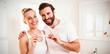 Leinwanddruck Bild - Portrait of happy couple checking pregnancy test