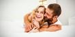 Leinwanddruck Bild - Young couple embracing on bed