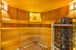 Leinwanddruck Bild - Amazing home sauna room with cedar wood walls and bench