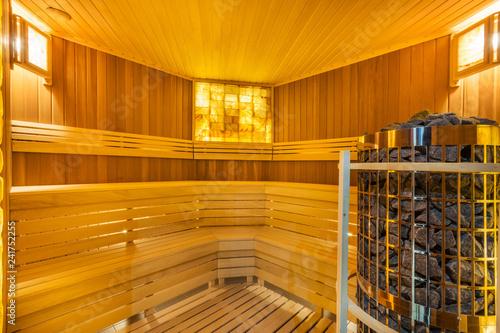 Leinwanddruck Bild Amazing home sauna room with cedar wood walls and bench