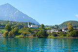 Faulensee village view from Lake Thun in the Bernese Oberland region in Switzerland.