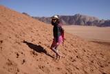 tourist on the dune at wadi rum - 241761697