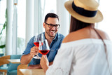 Couple romantic date drink glass of red wine at restaurant. - Image - 241772094