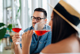 Couple romantic date drink glass of red wine at restaurant. - Image - 241772248