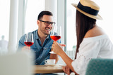 Young happy amorous couple celebrating with red wine at restaurant. - Image - 241772429