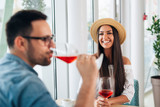 Happy couple romantic date drink glass of red wine at restaurant. - Image - 241772617