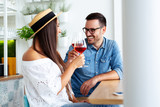 Happy couple romantic date drink glass of red wine at restaurant. - Image - 241773258