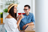 Happy couple romantic date drink glass of red wine at restaurant. - Image - 241773276