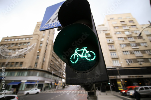 Green traffic lights for bikers and crosswalk sign