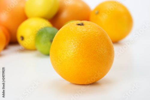 orange on the background of different citrus fruits on white background - 241799211