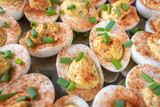 Group of Deviled Eggs with paprika and green onions flat lay - 241807228