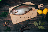 Fototapeta Tęcza - red fish on a wooden cutting Board . rainbow trout © alexkoral