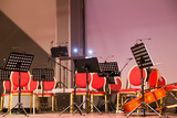 Musical instruments of symphonic orchestra and music stands for music on the concert stage - 241822840