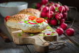 Spring sandwich with fromage cheese and fresh cherry tomatoes - 241832028