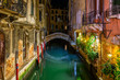 Narrow canal with bridge in Venice, Italy. Architecture and landmark of Venice. Night cozy cityscape of Venice.