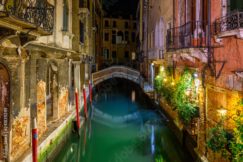 Narrow canal with bridge in Venice, Italy. Architecture and landmark of Venice. Night cozy cityscape of Venice. - 241839249