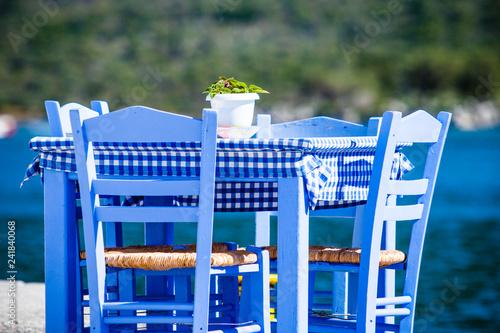 Open cafe outdoor restaurant in Greece on sea shore