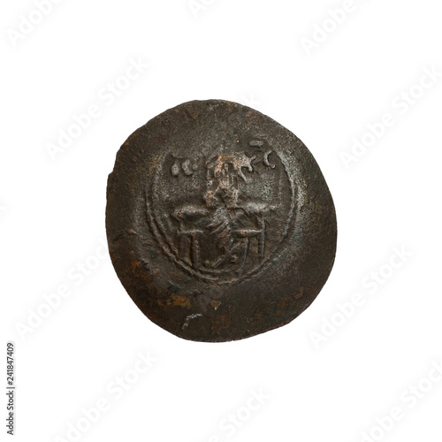 Concave ancient copper or bronze byzantine coin isolated on white