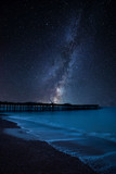 Vibrant Milky Way composite image over landscape of pier under construction and development - 241853621