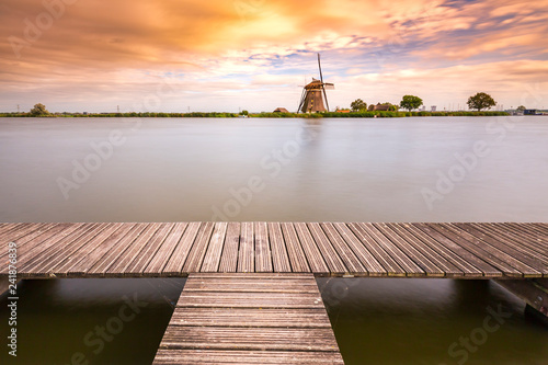 Old Dutch traditional windmill located at Rottemeren during sunset