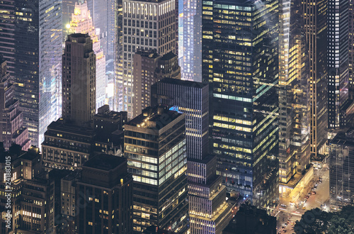 Aerial view of New York City modern buildings at night, color toned picture, USA.
