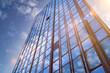 Leinwanddruck Bild - Hochhaus Wolkenkratzer mit Gegenlicht